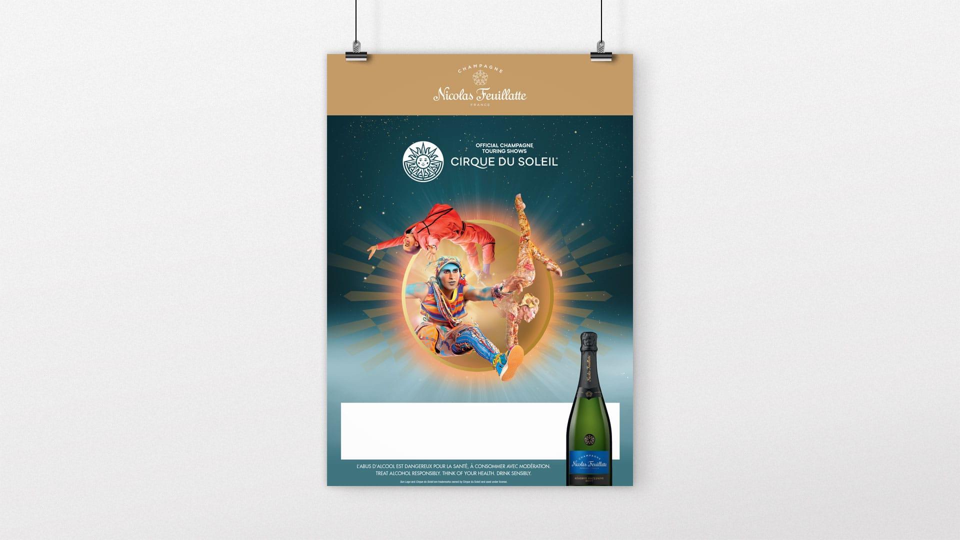 Il y a un poster de la marque de champagne Nicolas Feuillatte qui met en avant son partenariat avec le Cirque du Soleil. Support réalisé par l'agence de communication print Siouxe.