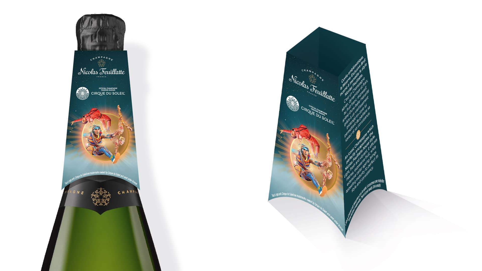 Il y a le haut d'une bouteille de champagne, de la marque de champagne Nicolas Feuillatte avec un support qui met en avant le partenariat de Nicolas Feuillatte avec le Cirque du soleil. Supports réalisés par l'agence de communication et marketing Siouxe.